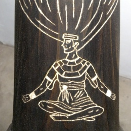 Carved figure on the side of the drum
